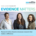 The cover image of Evidence Matters - three women smile at the camera, they are the winners of the Research Action Awards 2019.