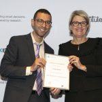 NSW Health Secretary, Ms Elizabeth Koff presents NSW Biostatistics Training Program graduate Joseph Hanna with his certificate