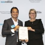 NSW Health Secretary, Ms Elizabeth Koff presents NSW Public Health Training Program graduate Angus Liu with his certificate