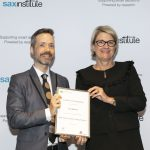 NSW Health Secretary, Ms Elizabeth Koff presents NSW Public Health Training Program graduate Nick Roberts with his certificate