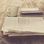 reading the health wrap with a coffee